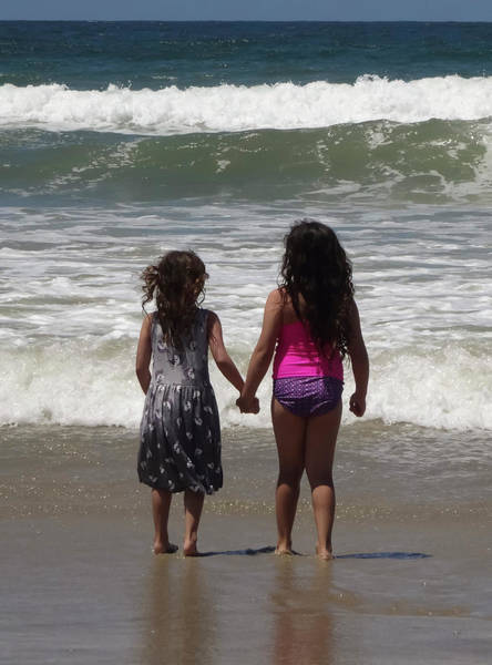 Bracing Photograph - A Pair Of Sisters Brace For An Oncoming Wave by Derrick Neill