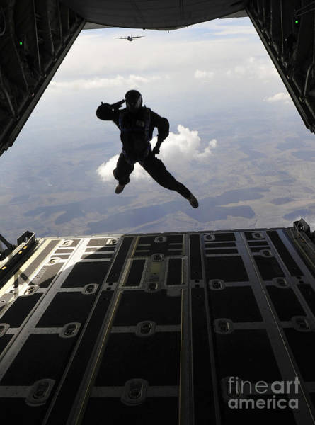 Skydiver Photograph - A Paratrooper Salutes As He Jumps by Stocktrek Images
