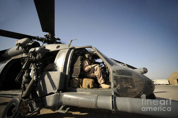 Flight Deck Photograph - A Pilot Sits In The Cockpit Of A Hh-60g by Stocktrek Images