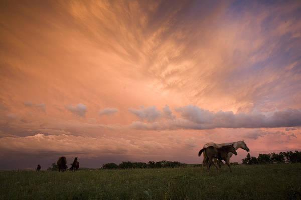 Tallgrass Wall Art - Photograph - A Receding Thunderstorm Creates by Jim Richardson