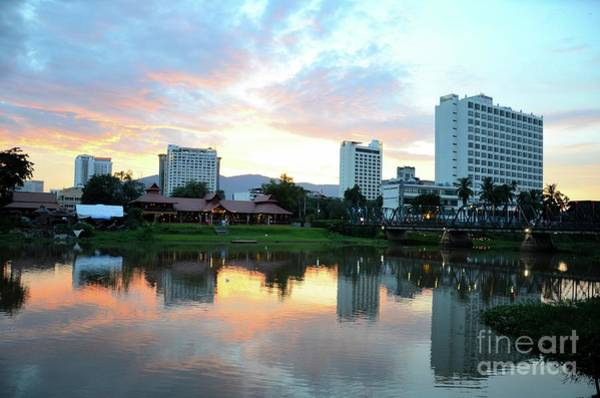 Photograph - A Restaurant And Buildings Across The Mae Ping River At Sunset Chiang Mai Thailand  by Imran Ahmed