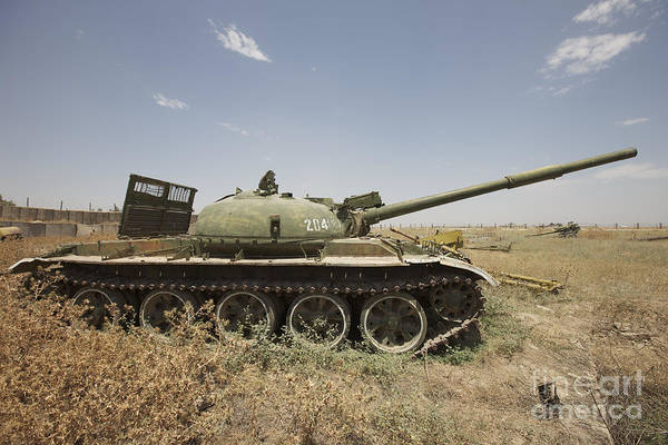 Battle Field Photograph - A Russian T-62 Main Battle Tank Rests by Terry Moore