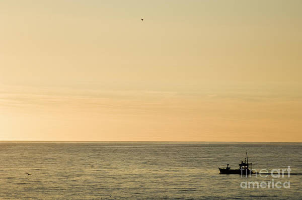 A Small Fishing Boat In Sunset Over Cardigan Bay Aberystwyth Ceredigion West Wales Art Print
