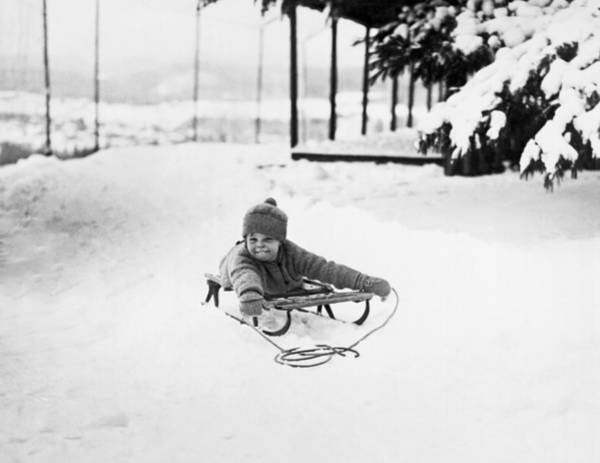 Wall Art - Photograph - A Small Girl On A Sled by Underwood Archives