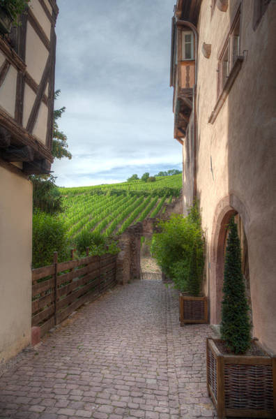 Alsace Wall Art - Photograph - A  Small Side Street In Riquewihr by W Chris Fooshee