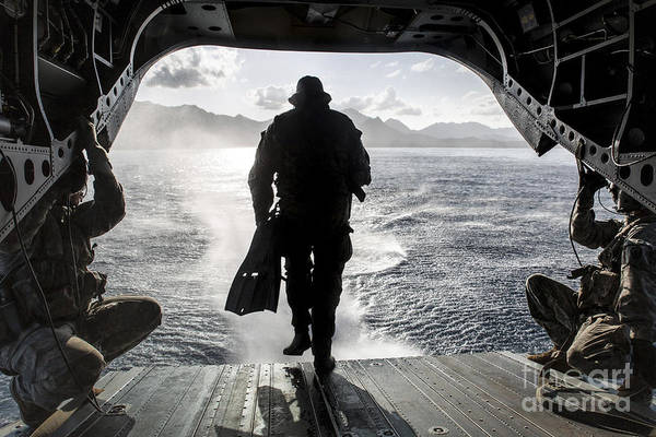 Aerial Combat Photograph - A Soldier Conducts A Combat Dive by Stocktrek Images