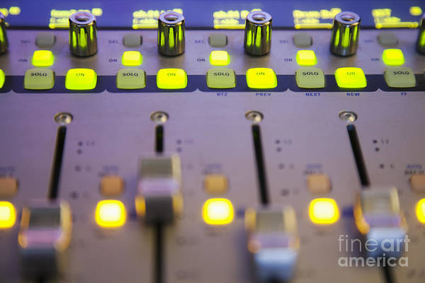 Wall Art - Photograph - A Sound Board With Lighted Controls by Roberto Westbrook