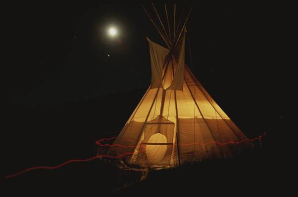 Camping Wall Art - Photograph - A Tepee Is Illuminated by Michael Melford