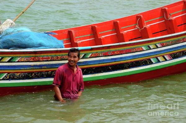 Photograph - A Thai Fisherman Stands In Water By His Boat Pattani Thailand by Imran Ahmed