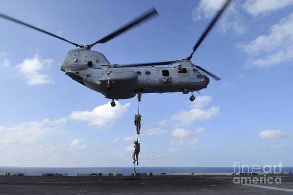 Amphibious Assault Ship Wall Art - Photograph - A Trio Of Marines Fast Rope by Stocktrek Images