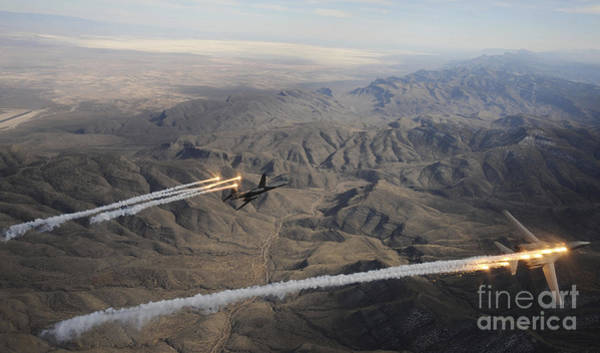 Aerial Combat Photograph - A Two Ship Of  B-1b Lancers Release by Stocktrek Images
