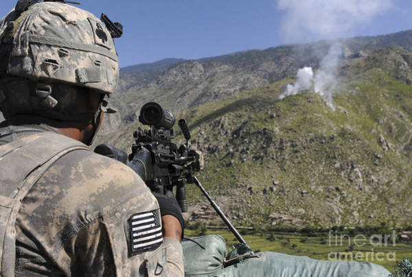 Gunfire Photograph - A U.s. Army Grenadier Scans A Nearby by Stocktrek Images