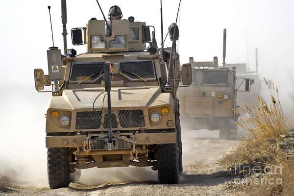 Atv Photograph - A U.s. Army M-atv Leads A Convoy by Stocktrek Images