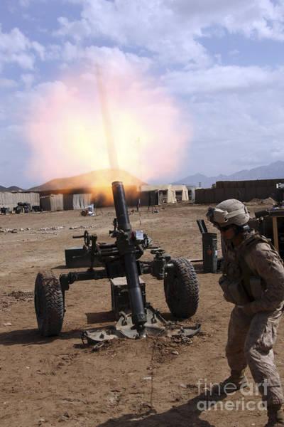 Gunfire Photograph - A U.s. Marine Corps Gunner Fires by Stocktrek Images