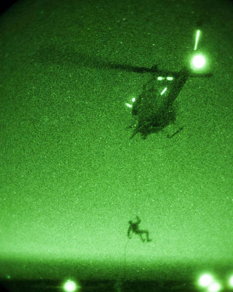 Photograph - A U.s. Marine Rappels From A Uh-1n Huey Helicopter by Celestial Images