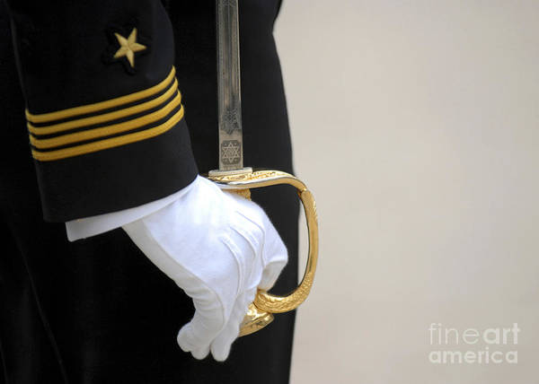 Wall Art - Photograph - A U.s. Naval Academy Midshipman Stands by Stocktrek Images