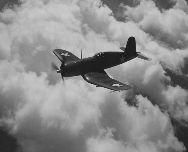 Grey Cloud Photograph - A Us Navy Fighter Corsair In Flight by American School