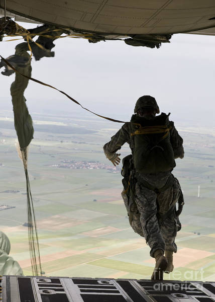Skydiver Photograph - A U.s. Soldier Jumps Out Of A C-130j by Stocktrek Images