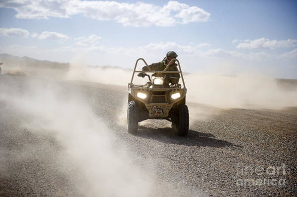 Four Wheeler Photograph - A U.s. Soldier Performs Off-road by Stocktrek Images