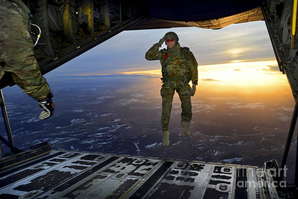 Skydiver Photograph - A U.s. Soldier Salutes His Fellow by Stocktrek Images