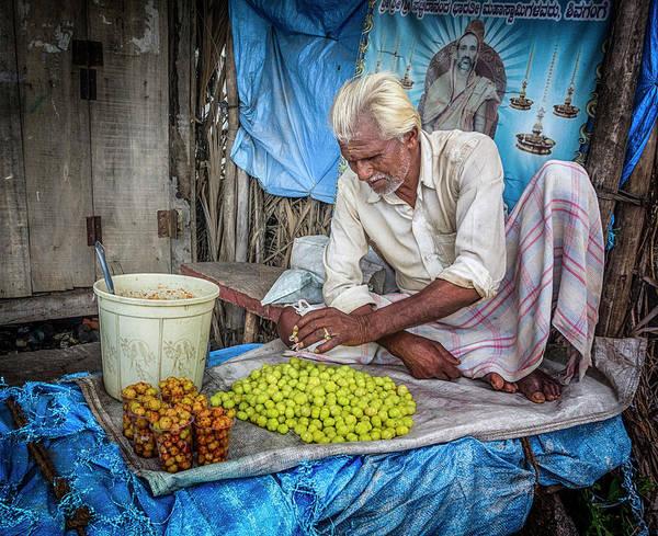 Photograph - A Vendor. by Usha Peddamatham
