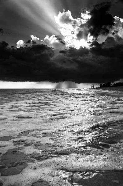 Walking In The Rain Wall Art - Photograph - A Walk On The Beach In Black And White by Greg and Chrystal Mimbs
