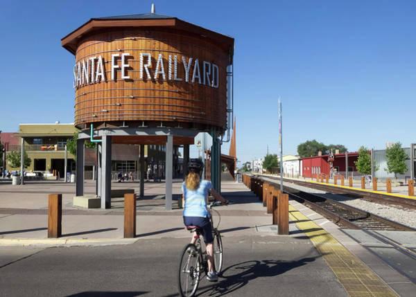 Wall Art - Photograph - A Woman Cyclist Begins The Santa Fe Rail Trail, New Mexico, Usa by Derrick Neill