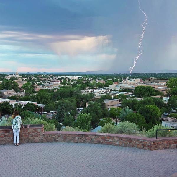 Wall Art - Photograph - A Woman Watches A Lightning Storm From Fort Marcy Park by Derrick Neill