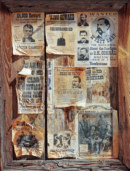 Gunfight Wall Art - Photograph - A Wooden Frame Full Of Wanted Posters by Derrick Neill