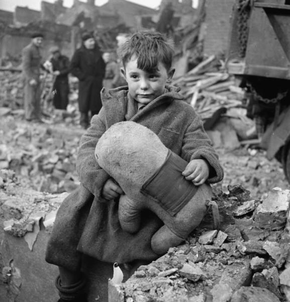 Painting - Abandoned Boy Holding A Stuffed Toy Animal Amid Ruins Following German Aerial Bombing Of London, 194 by Celestial Images