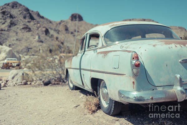 Car Wreck Wall Art - Photograph - Abandoned Old Blue Car In The Nevada Desert by Edward Fielding