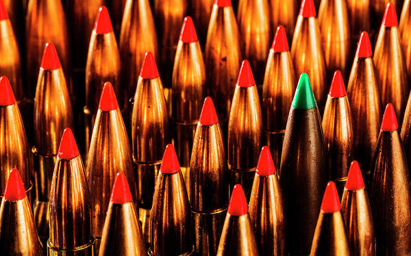Photograph - Abstract Pattern Of Standing Bullets by Maggie McCall