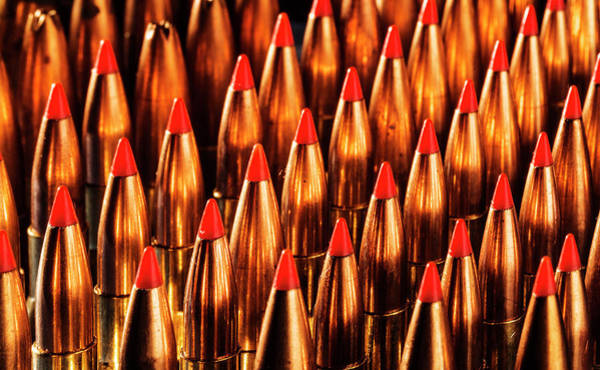 Photograph - Abstract Pattern Of Standing  Rifle Bullets by Maggie McCall