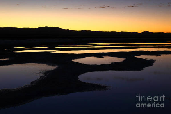 Photograph - Abstract Pools And Silhouettes Salar De Uyuni by James Brunker