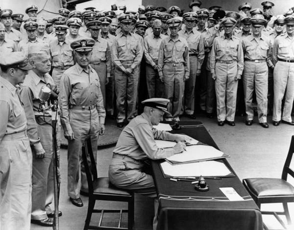Wwii Photograph - Admiral Nimitz Signing The Japanese Surrender  by War Is Hell Store