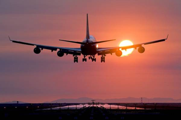 Landing Gear Photograph - Aeroplane Landing At Sunset, Canada by David Nunuk