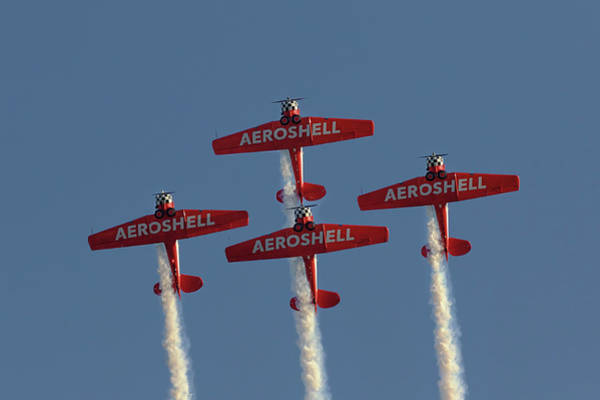Photograph - Aeroshell Aerobatic Team by Susan Rissi Tregoning