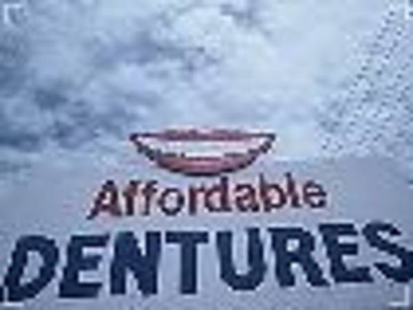 Visual Language Photograph - Affordable Dentures- The Signs Of The Times Collection by The Signs Of The Times Collection