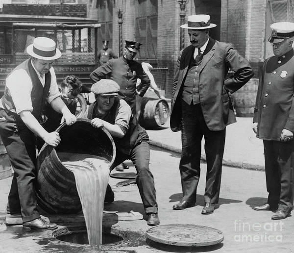 Wall Art - Photograph - Agents Pouring Alcohol Down A Sewer During Prohibition Era by American School