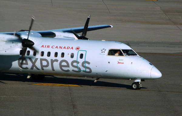 Vancouver International Airport Wall Art - Photograph - Air Canada Express Dash 8-300 Up Close by Darrell MacIver