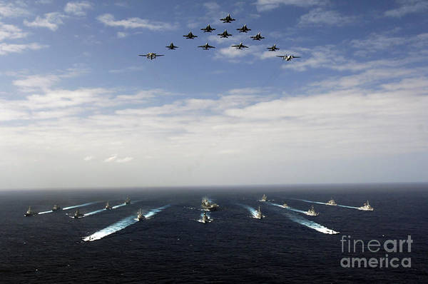 A-18 Hornet Wall Art - Photograph - Aircraft Fly Over A Group Of U.s by Stocktrek Images