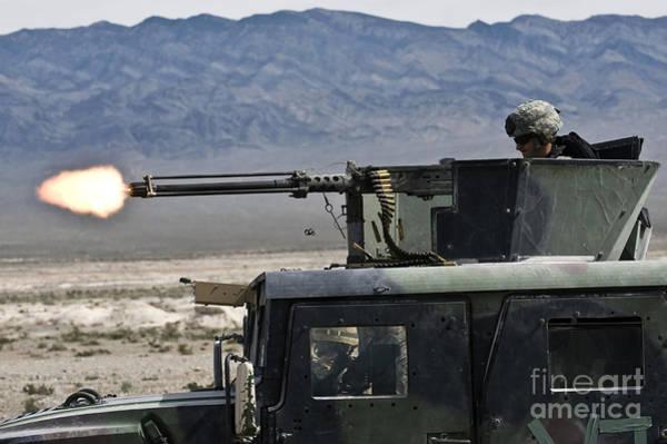 Gunfire Photograph - Airman Fires A .50 Caliber Heavy by Stocktrek Images