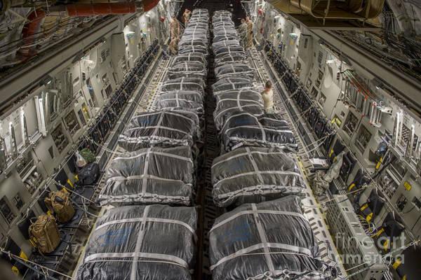 C-17 Photograph - Airmen Prepare Pallets On A C-17 by Stocktrek Images
