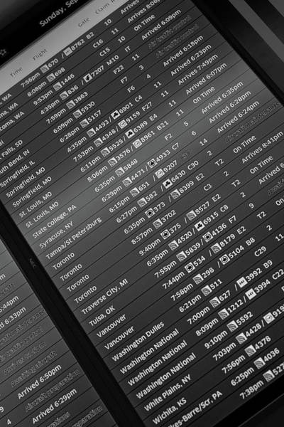 Wall Art - Photograph - Airport Arrival Board B W by Steve Gadomski
