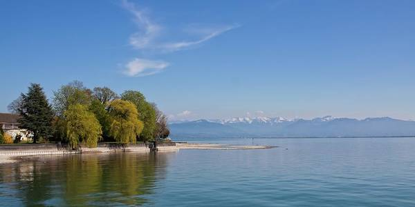 Photograph - The Alps Accross The Lake by Tatiana Travelways