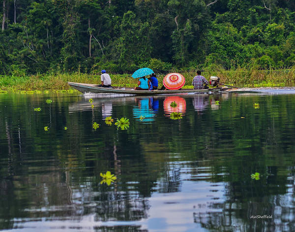Photograph - Amazon River Taxi With Umbrellas by Allen Sheffield