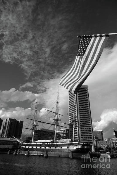 Photograph - American Flag And Inner Harbor Baltimore by James Brunker