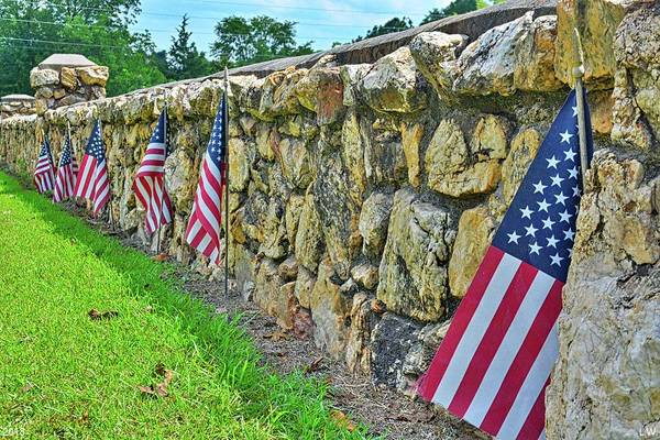 Photograph - American Flags Along A Stone Cemetery Wall by Lisa Wooten