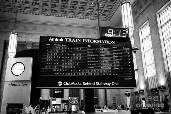 Wall Art - Photograph - amtrak train information board in main waiting room inside septa 30th street train station Philadelp by Joe Fox