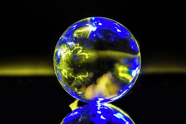 Photograph - An Abstract Blue And Yellow Glass Ball Image by Sven Brogren